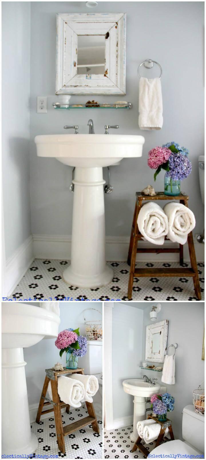 reclaimed vintage step ladder into bathroom organizer