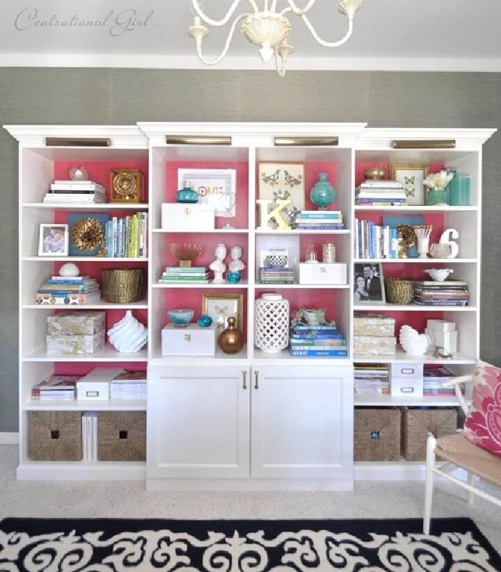 DIY IKEA BILLY-BESTA Bookshelf Wall with Pink Backing and Brass Lighting