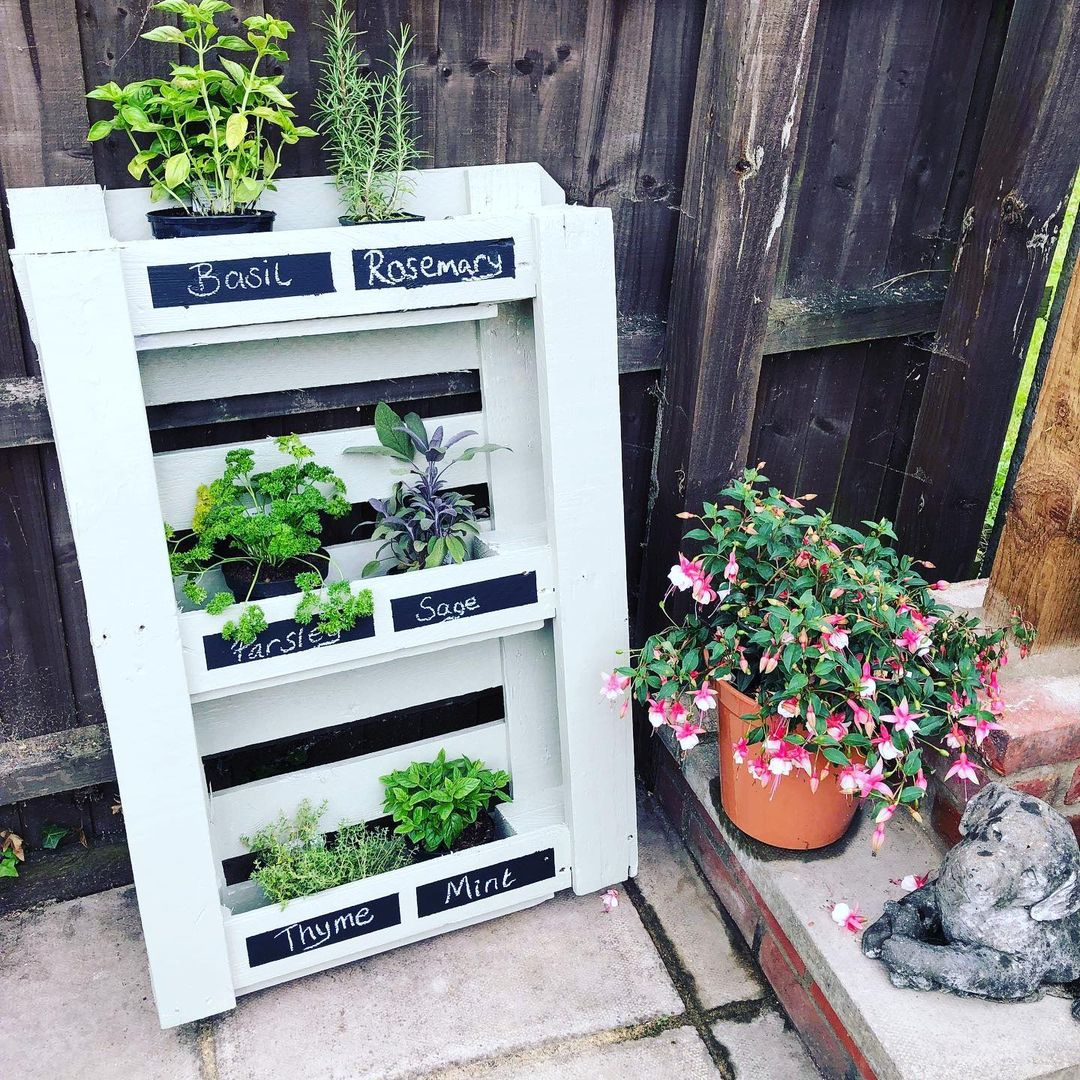 Finished pallet herb garden project just need to plant a few more herbs and wait for some seeds to grow